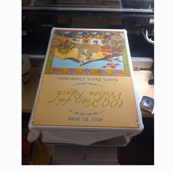 Wilson Ranch anniversary tea towel on the press